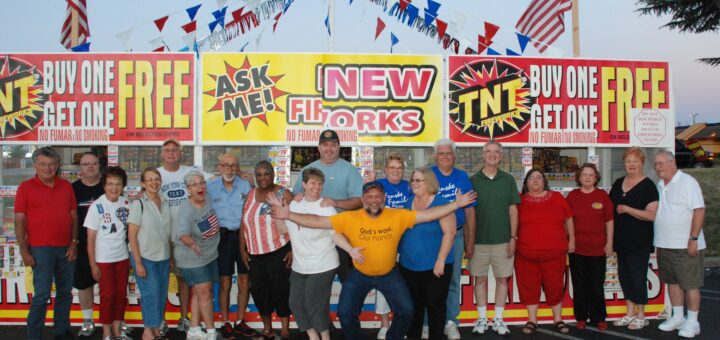 2014 photo of a lot of the fireworks booth volunteers
