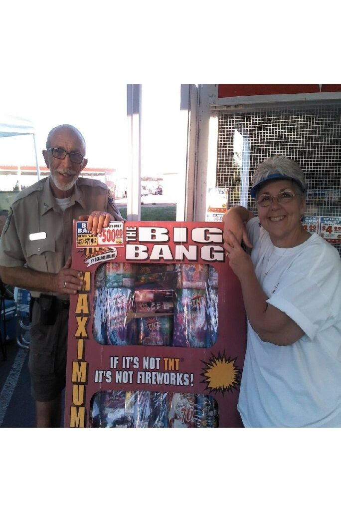 photo of Al and Peggy Moser showing off the Big Bang fireworks assortment in 2012